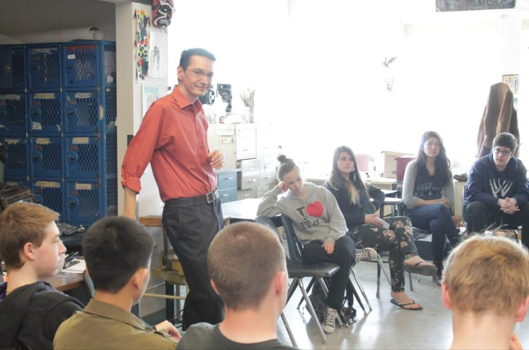Kevin Lamoureux talking with students